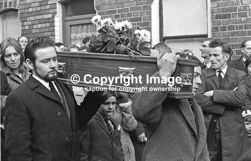 Funeral of 17 months old Tracey Munn, of Alloa Street,, Belfast, N Ireland, UK. Tracey was one of two children who died in a no warning Provisional IRA attack at a Shankill Road furniture store on 11th December 1971. The other child was 17 months old Colin Nicholl, of Colin Nicholl of Elimgrove Street, Belfast. The two funerals joined up in Clifton Park Avenue on the way to the cemetery. 197111410534c<br />
