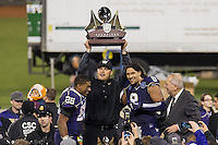 SAN FRANCISCO, CA - December 27, 2013: Washington Huskies tailback Bishop Sankey (25), head coach Marques Tuasosopo, and defensive end Hau'oli Kikaha (8) celebrate winning the 2013 Kraft Fight Hunger Bowl where the Washington Huskies and the BYU Cougars at AT&T Park in San Francisco, California. Final score Washington Huskies 31, BYU Cougars 16.