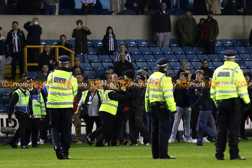 A Millwall steward tries to calm down some Millwall supporters after they invaded the pitch at the final whistle during Millwall vs Scunthorpe United, Sky Bet EFL League 1 Play-Off Football at The Den on 4th May 2017