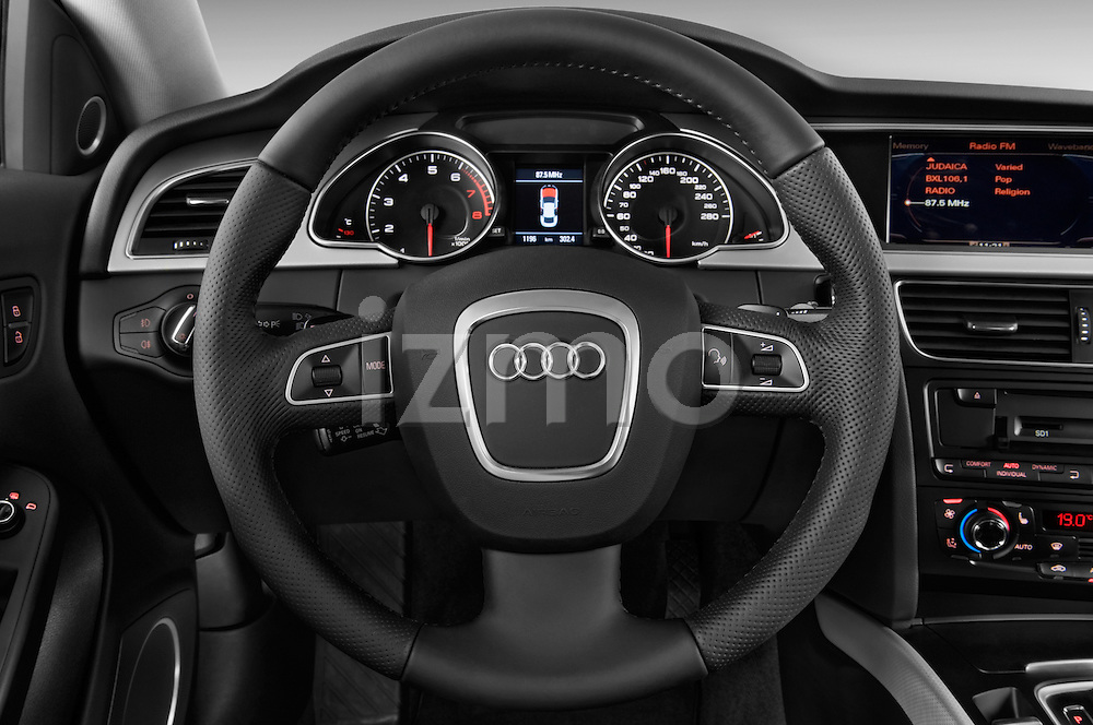 Steering wheel view of a 2009 - 2011 Audi A5 Ambition Luxe Sportback 5-Door Hatchback.