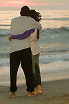 Mature couple hugging at beach