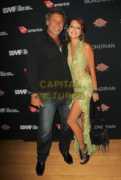 Steven Bauer and Guest.5th Annual Sunset Strip Music Festival Held At  SkyBar at Mondrian, West Hollywood, California, USA, .17th August 2012..Full length black shirt jeans necklace smiling .CAP/ADM/KB.©Kevan Brooks/AdMedia/Capital Pictures.