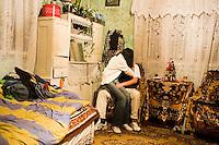 ROMANIA / Maramures / Sarbi / 28.09.2006 ..Anuta, 16, with Liviu, 18. ..© Davin Ellicson / Anzenberger