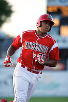 Batavia Muckdogs first baseman David Washington #28 rounds the bases after a home run during a game against the Staten Island Yankees at Dwyer Stadium on July 30, 2012 in Batavia, New York.  Batavia defeated Staten Island 5-4 in 11 innings.  (Mike Janes/Four Seam Images)