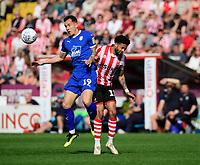Lincoln City's Bruno Andrade vies for possession with Tranmere Rovers' Kieron Morris<br /> <br /> Photographer Chris Vaughan/CameraSport<br /> <br /> The EFL Sky Bet League Two - Lincoln City v Tranmere Rovers - Monday 22nd April 2019 - Sincil Bank - Lincoln<br /> <br /> World Copyright © 2019 CameraSport. All rights reserved. 43 Linden Ave. Countesthorpe. Leicester. England. LE8 5PG - Tel: +44 (0) 116 277 4147 - admin@camerasport.com - www.camerasport.com