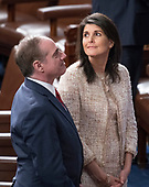 United States Secretary of Veterans Affairs David J. Shulkin, left, and US Ambassador to the United Nations Nikki Haley, right, depart after US President Donald J. Trump delivered his first State of the Union address to a joint session of the US Congress in the US House chamber in the US Capitol in Washington, DC on Tuesday, January 30, 2018.<br /> Credit: Ron Sachs / CNP