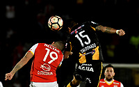 BOGOTA - COLOMBIA – 23 – 05 - 2017: Denis Straqualursi (Der.) jugador de Independiente Santa Fe, disputa el balon con Luis Maldonado (Izq.) jugador de The Strongest, durante partido entre Independiente Santa Fe de Colombia y The Strongest de Bolivia, de la fase de grupos, grupo 2, fecha 6 por la Copa Conmebol Libertadores Bridgestone 2017, en el estadio Nemesio Camacho El Campin, de la ciudad de Bogota. / Denis Straqualursi (R) player of Independiente Santa Fe, fights for the ball with Luis Maldonado (L) player of The Strongest during a match between Independiente Santa Fe of Colombia and The Strongest of Bolivia, of the group stage, group 2 of the date 6th, for the Conmebol Copa Libertadores Bridgestone 2017 at the Nemesio Camacho El Campin in Bogota city. VizzorImage / Luis Ramirez / Staff.