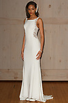 Model poses in a Galina Signature bridal gown for the David's Bridal Fall 2017 fashion show presentation on April 19, 2017; during New York Bridal Fashion Week.
