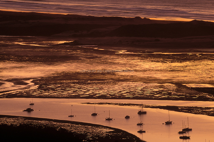 Morro Bay, state and national estuary, at sunset. Declared a California Marine Reserve by the California Fish and Game Commission. San Luis Obispo County, CA.