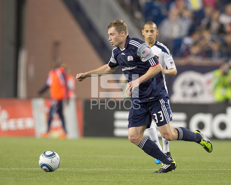 New England Revolution midfielder Zak Boggs (33) dribbles. In a Major League Soccer (MLS) match, the Los Angeles Galaxy defeated the New England Revolution, 1-0, at Gillette Stadium on May 28, 2011.