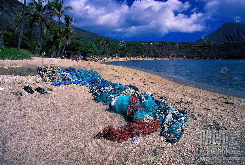 Discarded fishing nets entangle in coral and kill reef fishes or wash up on Hawaii's pristine beaches creating environmental hazards.