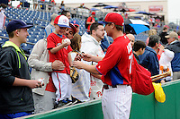 Philadelphia Phillies third baseman Cody Asche #72 signs autographs for a young fan before a Spring Training game against the New York Yankees at Bright House Field on February 26, 2013 in Clearwater, Florida.  Philadelphia defeated New York 4-3.  (Mike Janes/Four Seam Images)