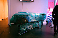 NEW YORK--SEP 12 Inside Diane von Furstenberg's town house, a baby grand piano is wrapped in plastic before the Diane von Furstenberg fashion show during Olympus Fashion Week Spring 2005 in New York City on September 12, 2004. (Photo by Landon Nordeman/Getty Images)