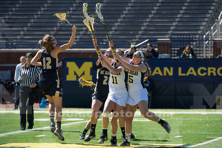 The University of Michigan women's lacrosse team defeats UC-Davis, 13-12, in four overtimes, at Michigan Stadium in Ann Arbor on March 30, 2014.