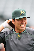 Oakland Athletics catcher Kurt Suzuki #8 before a game against the Los Angeles Angels at Angel Stadium on September 24, 2011 in Anaheim,California. Los Angeles defeated Oakland 4-2.(Larry Goren/Four Seam Images)