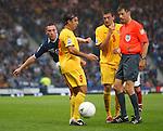Scott Brown kicks the drop ball off defender Igor Mitreski for a corner to Scotland