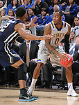 SIOUX FALLS, SD - MARCH 5:  Deondre Parks #0 of South Dakota State looks to pass against Aaron Anderson #2 of Oral Roberts in the 2016 Summit League Tournament. (Photo by Dick Carlson/Inertia)