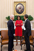 United States President Barack Obama and Vice President Joe Biden talk with First Lady Michelle Obama in the Oval Office of the White House in Washington, D.C., November 21, 2011. .Mandatory Credit: Pete Souza - White House via CNP