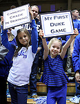 26 November 2014: Two young Duke fans spend their first game with the Cameron Crazies. The Duke University Blue Devils hosted the Furman University Paladins at Cameron Indoor Stadium in Durham, North Carolina in a 2014-16 NCAA Men's Basketball Division I game. Duke won the game 93-54.