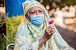 Sudanese woman sits next to his husband holds a rose while wearing a mask, as a precaution against the spread of the coronavirus disease (COVID-19) in Khartoum, Sudan on May 05, 2020. Photo by faiz Abu bakr