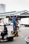 Tokyo, June 25 2013 - Traffic policeman at tsukiji fish market.