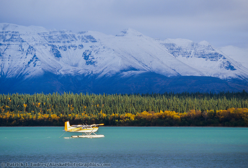 Bush plane on floats takes off from Naknek lake, Katmai National park, Alaska