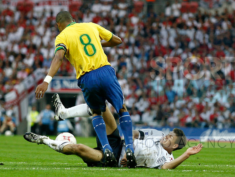 England's Steven Gerrard goes down under pressure from Brazil's Gilberto Silva..International Friendly..England v Brazil..1st June, 2007..--------------------..Sportimage +44 7980659747..admin@sportimage.co.uk..http://www.sportimage.co.uk/