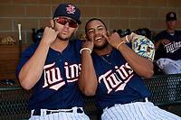 Elizabethton Twins Colton Burns (23) poses for a photo with Ricky De La Torre (7) in the dugout before a game against the Bristol Pirates on July 28, 2018 at Joe O'Brien Field in Elizabethton, Tennessee.  Elizabethton defeated Bristol 5-0.  (Mike Janes/Four Seam Images)
