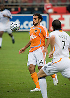 Houston Dynamo midfielder Dwayne De Rosario (14) attempts to pass around LA Galaxy defender Chris Klein (7). The LA Galaxy defeated the Houston Dynamo 2-1  in a regular season MLS match at Robertson Stadium in Houston, TX on October 7, 2007.