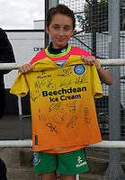 A young Wycombe Wanderers fan shows off his autographed shirt before the Friendly match between Maidenhead United and Wycombe Wanderers at York Road, Maidenhead, England on 30 July 2016. Photo by Alan  Stanford PRiME Media Images.