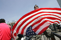 United States Men's National team fan Rishi Segal waves an American flag outside Azteca stadium before the game. The United States Men's National Team played Mexico in a CONCACAF World Cup Qualifier match at Azteca Stadium in, Mexico City, Mexico on Wednesday, August 12, 2009.