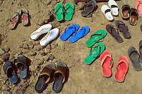 Mali. Province of Segou. Cinzana. Shoes outside the mosque on friday, day of the prayer in the islam culture.  © 2003 Didier Ruef