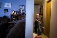 "Rod Scheaffer, 29, takes care of laundry at his home in Half Town, outside the Fort Belknap Agency near Harlem, Montana, USA.  Scheaffer is a member of the Fort Belknap College Eagles men's basketball team.  Scheaffer runs a concrete business, but decided to enroll with the minimum required credits at Fort Belknap College in order to play on the basketball team.  After 2 months at the college, ""I realized the real battlefield for our people is the education game,"" he said.  For his second semester, in 2011, Scheaffer will be taking a full load of classes as a step toward a degree in business administration.  Scheaffer says he would not have enrolled in college if not for the basketball team."