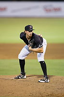 Kannapolis Intimidators relief pitcher J.B. Olson (24) looks to his catcher for the sign against the Greenville Drive at Kannapolis Intimidators Stadium on August 7, 2017 in Kannapolis, North Carolina.  The Drive defeated the Intimidators 6-1.  (Brian Westerholt/Four Seam Images)
