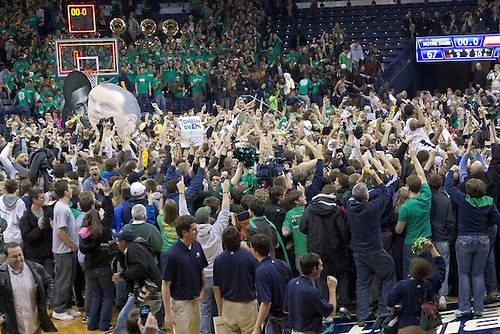Notre Dame fans rush the floor after Notre Dame upsets Syracuse.  The Notre Dame Fighting Irish defeated the Syracuse Orange 67-58 in game at Purcell Pavilion at the Joyce Center in South Bend, Indiana.