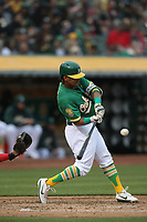 OAKLAND, CA - JUNE 15:  Khris Davis #2 of the Oakland Athletics bats against the Los Angeles Angels of Anaheim during the game at the Oakland Coliseum on Friday, June 15, 2018 in Oakland, California. (Photo by Brad Mangin)