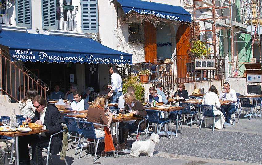 In the harbour in Cassis village.  Restaurants along the key side walk. Cassis Cote d'Azur Var France Bouches du Rhone
