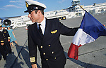 "John Travolta, captain and pilot, of his own jumbo jet, with the french flag, at Le  Bourget airport together with his plane and crew...John Travolta is pilot of his very own jumbo jet, a 1964 Boeing 707-100 series. In 2003, John Travolta flew his jumbo jet around the world, in partnership with Quantas, to rekindle confidence in commercial aviation, and to remind us that elegance and style are a part of flying. The crew are dressed in tailor made authentic uniforms from the Quantas museum. The men's uniforms are styled on British Naval uniforms and the ladies' designed by Chanel. His jumbo jet sports a personalised number plate N707JT which speaks for itself. The aircraft is named ""Jett Clipper Ella"" dedicated to his son and daughter. This jumbo together with his other aircraft are housed in purpose built hangars at his home in Florida, USA."