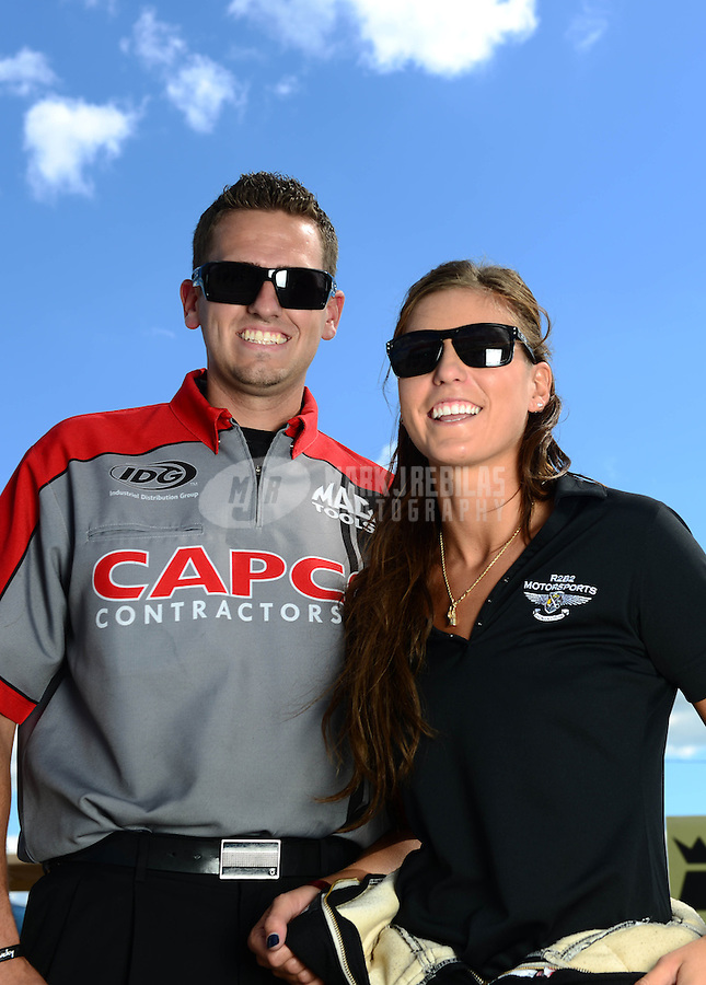 Sept 8, 2012; Clermont, IN, USA: NHRA crew member Gary Pritchett (left) with pro mod driver Leah Pruett during qualifying for the US Nationals at Lucas Oil Raceway. Mandatory Credit: Mark J. Rebilas-