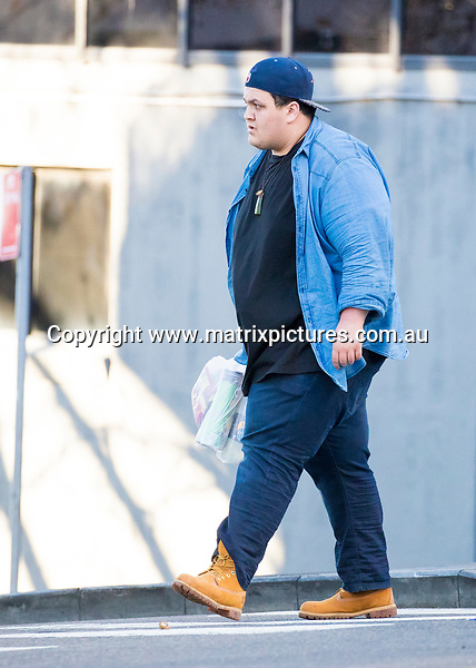 9 JULY 2017 SYDNEY AUSTRALIA<br /> WWW.MATRIXPICTURES.COM.AU<br /> <br /> EXCLUSIVE PICTURES<br /> <br /> The Voice 2017 winner Judah Kelly pictured in Darlinghurst leaving an Ezy Mart with some snacks and drinks. <br /> <br /> Note: All editorial images subject to the following: For editorial use only. Additional clearance required for commercial, wireless, internet or promotional use.Images may not be altered or modified. Matrix Media Group makes no representations or warranties regarding names, trademarks or logos appearing in the images.