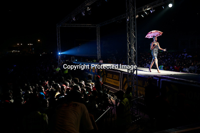 DAKAR, SENEGAL - JUNE 22: A model walks during a fashion show at Dakar Fashion Week on June 22, 2014, at Guediawaye in Dakar, Senegal. Seventeen Senegalese, African and foreign-based designers showed their collections during the week. A show was held outside in a poor area of Dakar. (Photo by Per-Anders Pettersson)