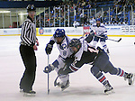 February 20, 2016 - Colorado Springs, Colorado, U.S. -   Air Force forward, Max Hartner #8, and Robert Morris forward, Brady Ferguson #12, battle for the puck during an NCAA ice hockey game between the Robert Morris University Colonials and the Air Force Academy Falcons at Cadet Ice Arena, United States Air Force Academy, Colorado Springs, Colorado.  Air Force defeats Robert Morris 4-1