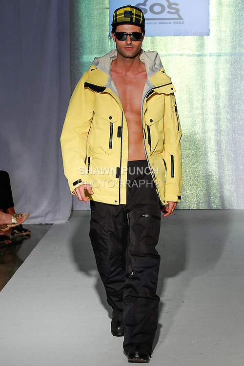 Model walks runway in an outfit from the SOS Sportswear collection, during the SNOW Fashion NYC - Ski fashion show, June 11, 2013.