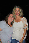 "General Hospital Laura Wright ""Carly"" poses with a fan at a Wine Tasting for Standing Sun Wines on August 11, 2012 at MaGooby's Joke House in Timonium, Maryland. The fans got a chance to takes all the various wines, a Q&A, photos, autographs. L(Photo by Sue Coflin/Max Photos)"