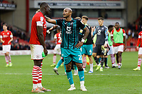 Andre Ayew of Swansea City (R) speaks to Bambo Diaby of Barnsley after the Sky Bet Championship match between Barnsley and Swansea City at Oakwell Stadium, Barnsley, England, UK. Saturday 19 October 2019