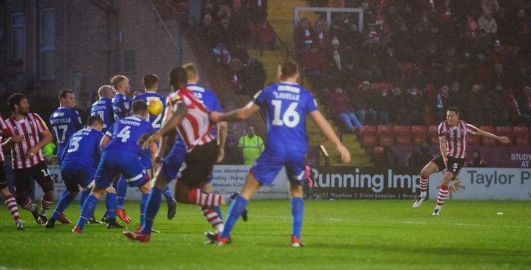 Lincoln City's Jason Shackell scores his side's third goal<br /> <br /> Photographer Chris Vaughan/CameraSport<br /> <br /> The EFL Sky Bet League Two - Saturday 15th December 2018 - Lincoln City v Morecambe - Sincil Bank - Lincoln<br /> <br /> World Copyright © 2018 CameraSport. All rights reserved. 43 Linden Ave. Countesthorpe. Leicester. England. LE8 5PG - Tel: +44 (0) 116 277 4147 - admin@camerasport.com - www.camerasport.com