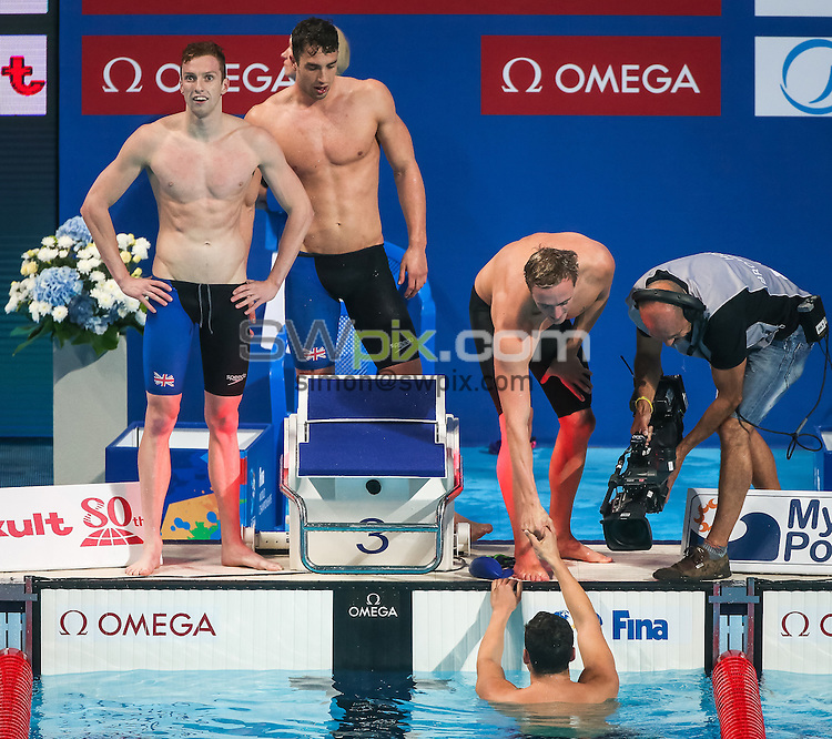 Picture by Alex Whitehead/SWpix.com - 07/08/2015 - Swimming - 16th FINA World Swimming Championships 2015 - Kazan Arena Stadium, Kazan, Russia - Great Britain's 4x200m Freestyle Relay team win Gold in the final, Dan Wallace, Calum Jarvis, Robbie Renwick and James Guy.