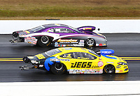 Mar 16, 2014; Gainesville, FL, USA; NHRA pro stock driver Jeg Coughlin Jr (near lane) races alongside Vincent Nobile during the Gatornationals at Gainesville Raceway Mandatory Credit: Mark J. Rebilas-USA TODAY Sports