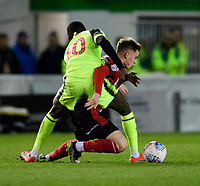 Lincoln City's Jake Hesketh is fouled by Bolton Wanderers' Yoan Zouma<br /> <br /> Photographer Chris Vaughan/CameraSport<br /> <br /> The EFL Sky Bet League One - Lincoln City v Bolton Wanderers - Tuesday 14th January 2020  - LNER Stadium - Lincoln<br /> <br /> World Copyright © 2020 CameraSport. All rights reserved. 43 Linden Ave. Countesthorpe. Leicester. England. LE8 5PG - Tel: +44 (0) 116 277 4147 - admin@camerasport.com - www.camerasport.com