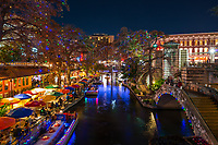 Another image  of the very festive San Antonio river walk with all the lights in the trees, the riverboats with there festive lights along with all the lights along the walk it is a wonderful place to go for the holidays.